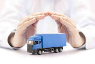 blue toy semi truck in hands of insurance adjuster